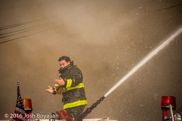 Chicago firefighter operates deck gun