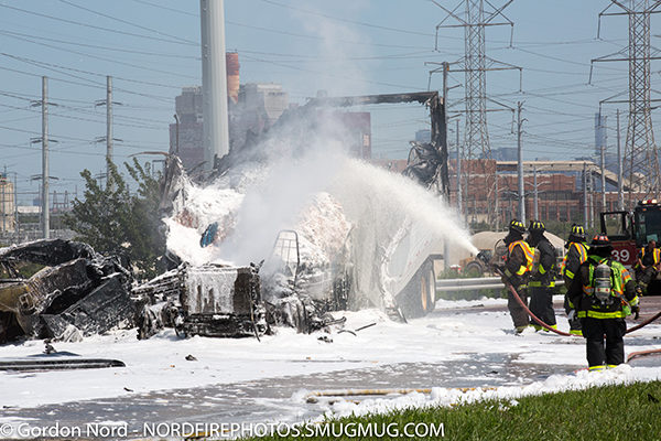 firefighters use foam after truck fire
