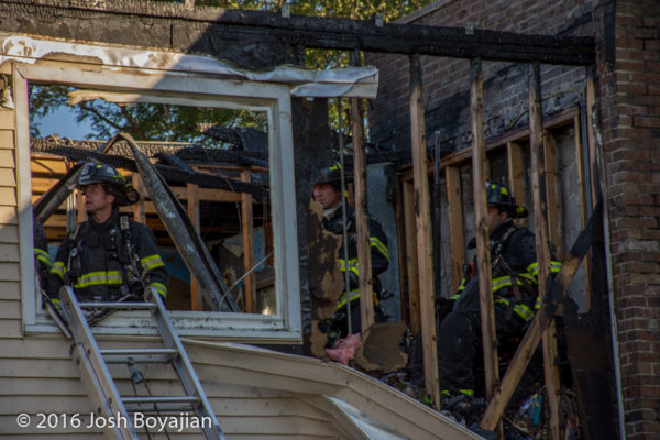 firefighters overhaul after apartment fire
