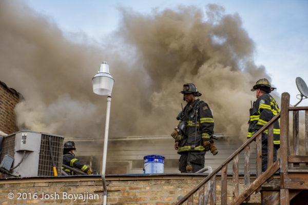 firefighters at work on roof