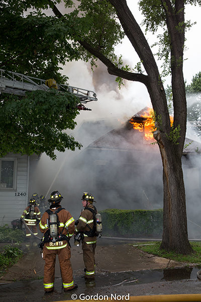 house on fire with heavy smoke and flames