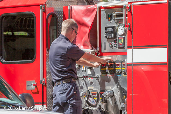 firefighter at E-ONE pump panel controls