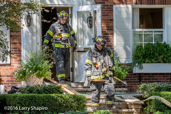 firefighters exit house after battling fire
