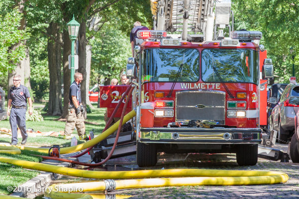 Wilmette E-ONE Cyclone tower ladder at fire scene with jacks deployed