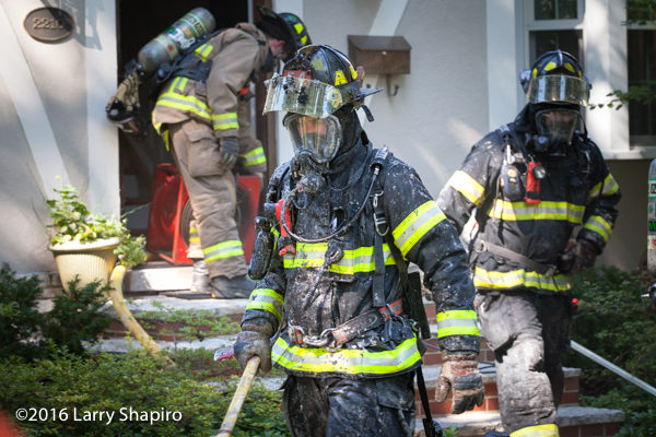 firefighter in PPE covered with insulation