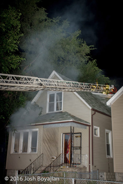 aerial ladder to house roof at nigh