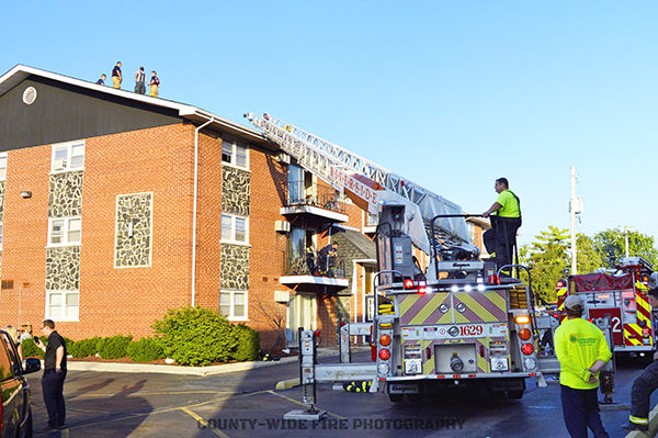 aerial ladder truck to apartment building roof after fire