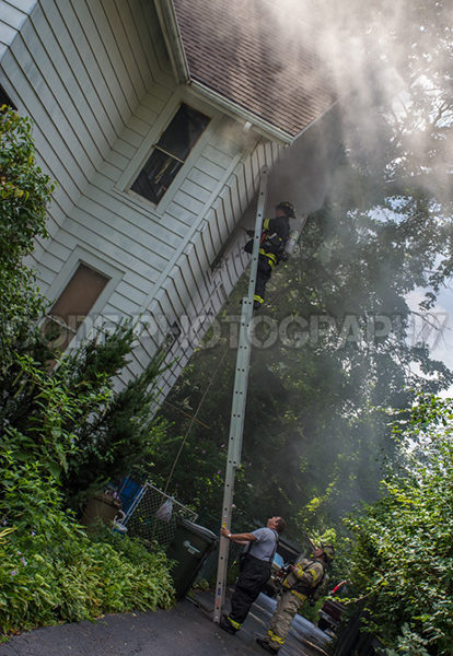 house fire with ladder to window