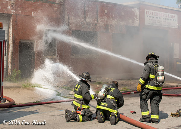 firefighters with big hose lines