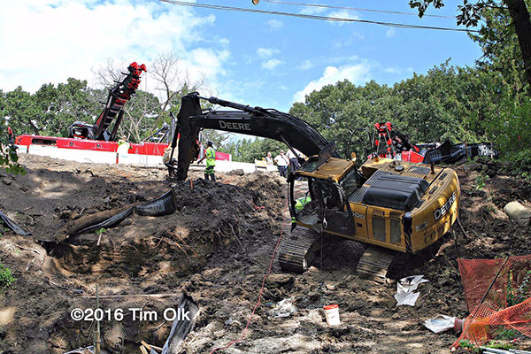 excavator rolls into ditch in Mundelein