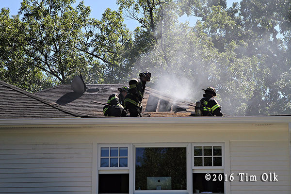 firefighters vent roof at house fire