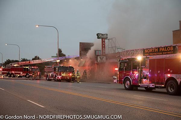 fire trucks at restaurant fire scene
