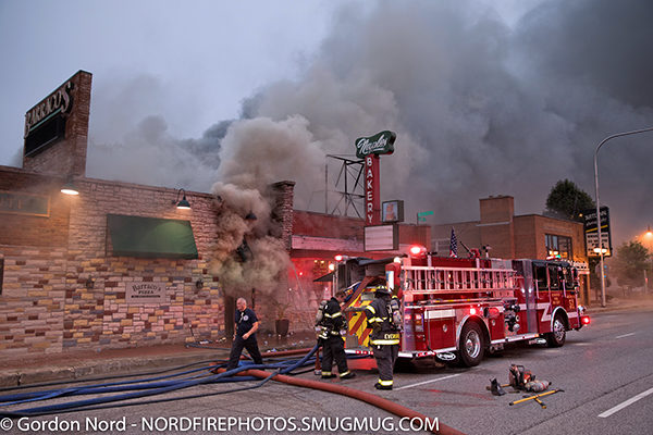 heavy smoke billows from restaurant on fire