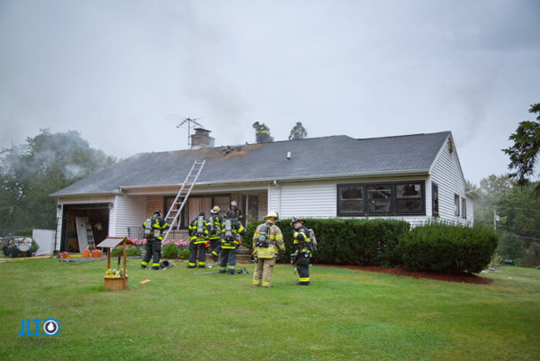 firefighters at house struck by lightning