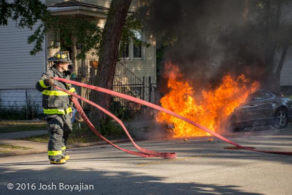 firefighters battle car fire