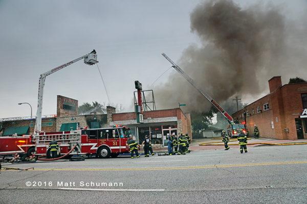 Snorkel and fire trucks at restaurant fire scene