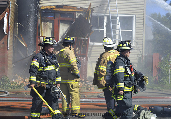 firefighters at fire scene