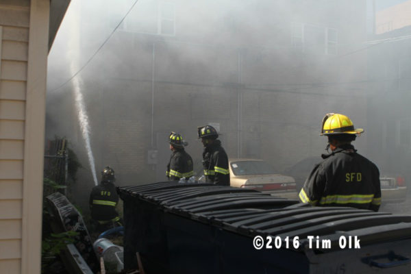 firefighters enveloped in smoke at fire scene