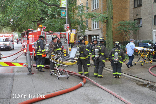 firefighters and paramedics at fire scene