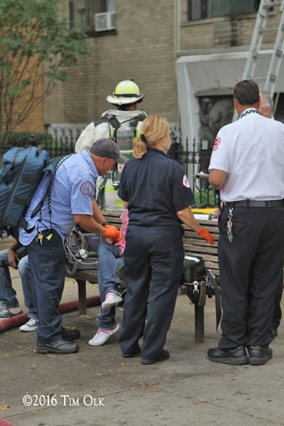 Chicago FD paramedics treat an elderly fire victim