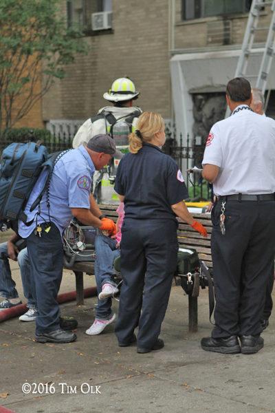 Chicago FD paramedics treat an elderly fire victim