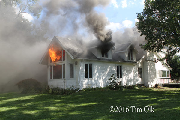 heavy smoke and flames from house fire