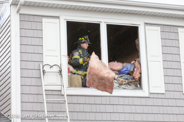 firefighter overhauls after fire