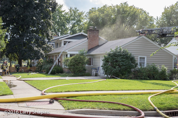 smoke from house fire in Northbrook IL