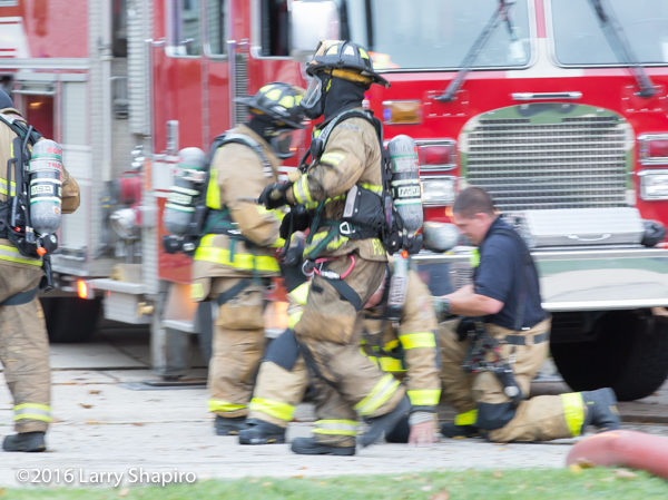 firefighter in PPE at fire scene