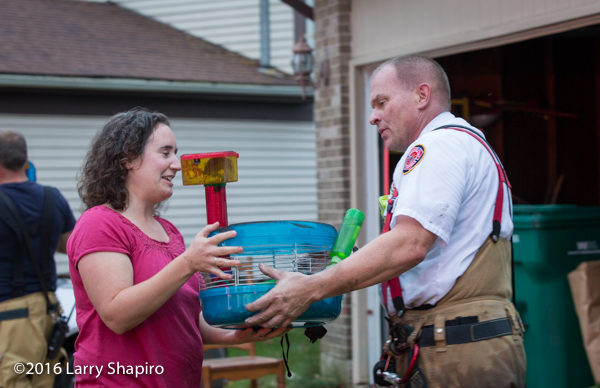 firefighter gives pets to fire victim