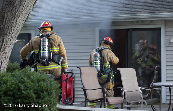 firefighters prepare to ventilate house