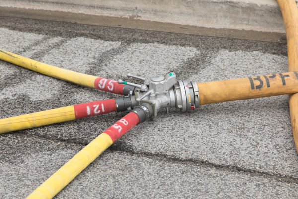 fire hose in street with wye connector