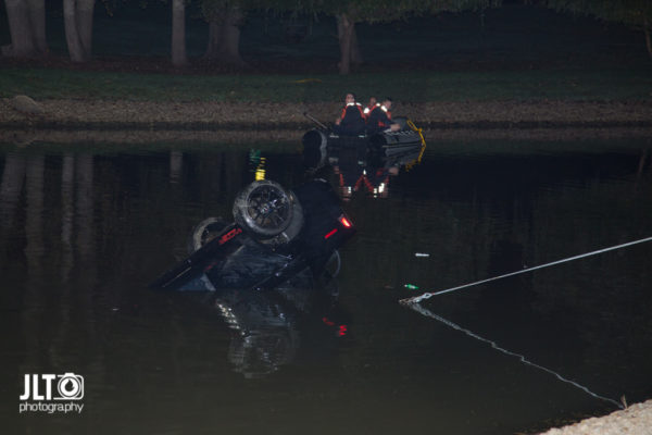 car retrieved from pond at night