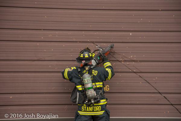 firefighters cut through overhead door