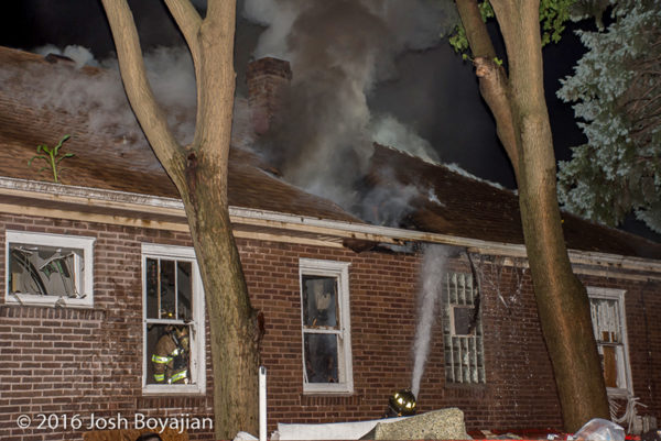 heavy smoke through roof at house fire