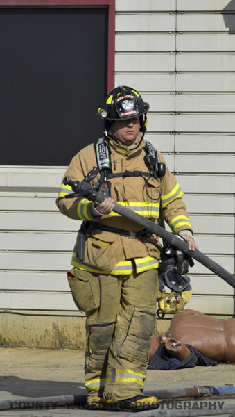 firefighter with hose training