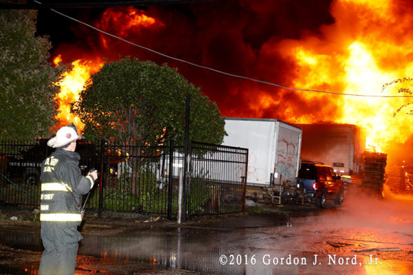 massive fire in truck yard at night