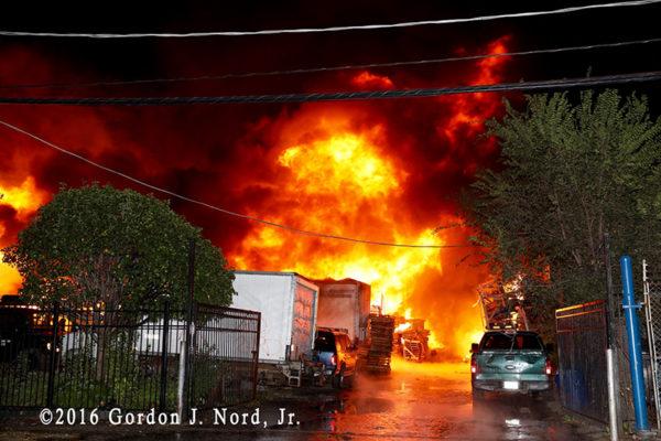 massive fire in truck yard at night