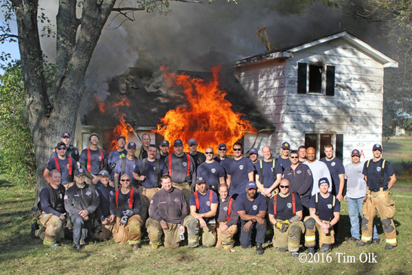firefighters from Waukegan pose with house burn down