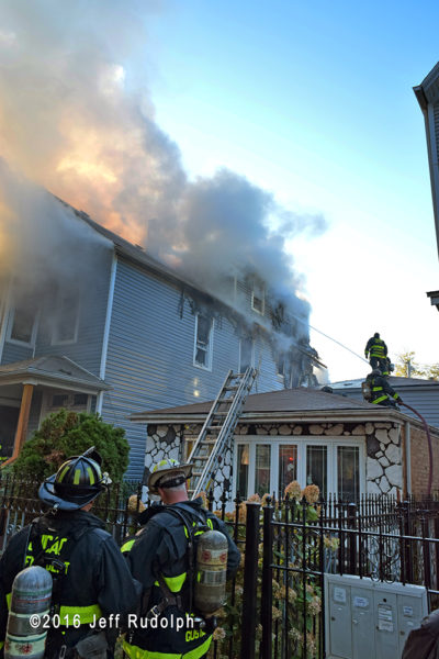 heavy smoke and flames at house fire