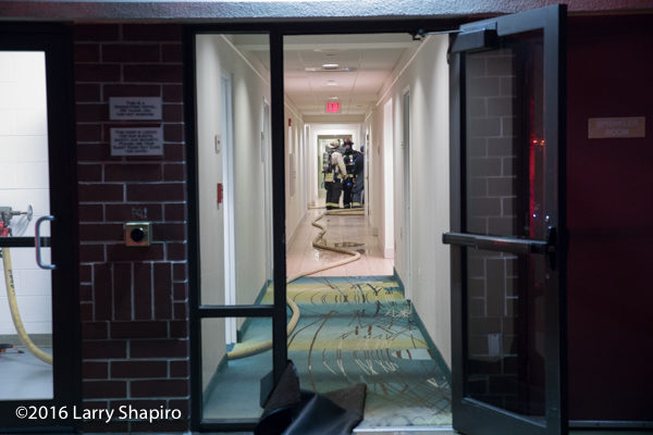 fire hose in hallway after hotel fire