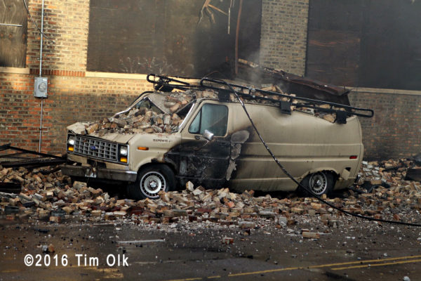 van crushed by falling bricks