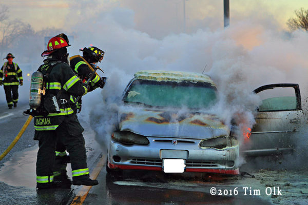 Firefighters at a car fire on the expressway