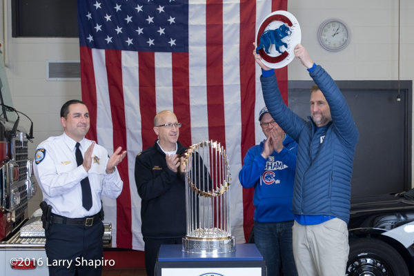 Winnetka police and fire chief and mayor with the World Series championship trophy.