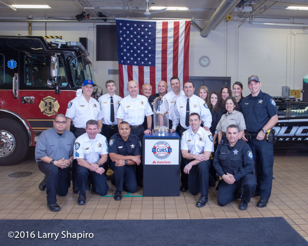 Winnetka police department personnel with the the World Series championship trophy