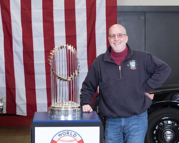 Larry Shapiro with the World Series championship trophy.