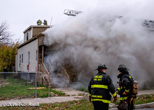 smoke billows from house on fire