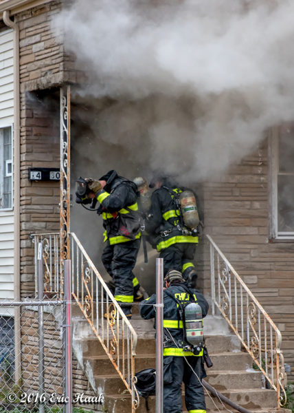Firefighters prepare to enter burning house