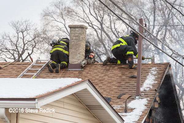 Chicago Firefighters venting a roof