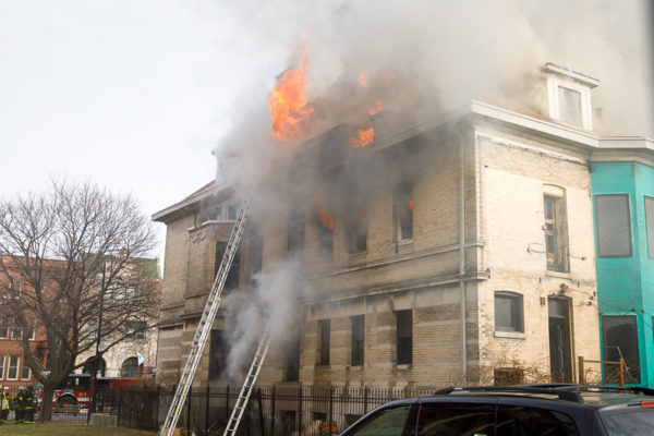 flames blowing out 2nd floor windows of mansion